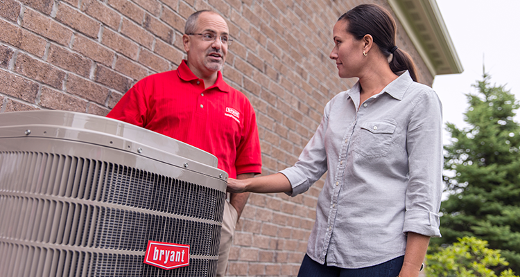 Bryant Heating and Cooling HVAC dealer outdoors with homeowner